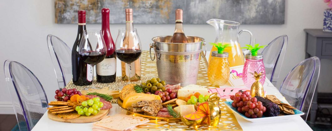 Table setting with assorted with Elouan wine bottles - charcuterie, assorted fruits